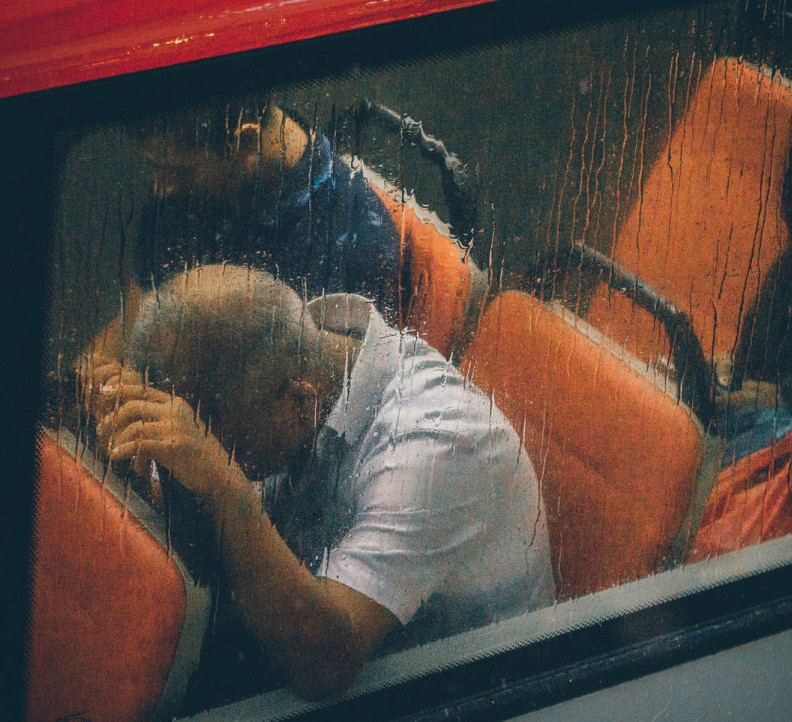 man on a bus - Photo by Lily Banse on Unsplash