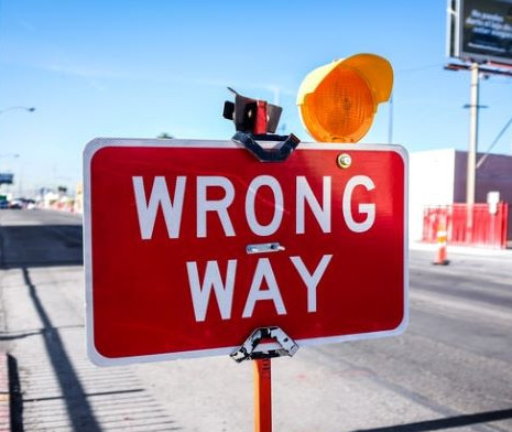 Going the wrong way sign - photo by NeONBRAND- unsplash